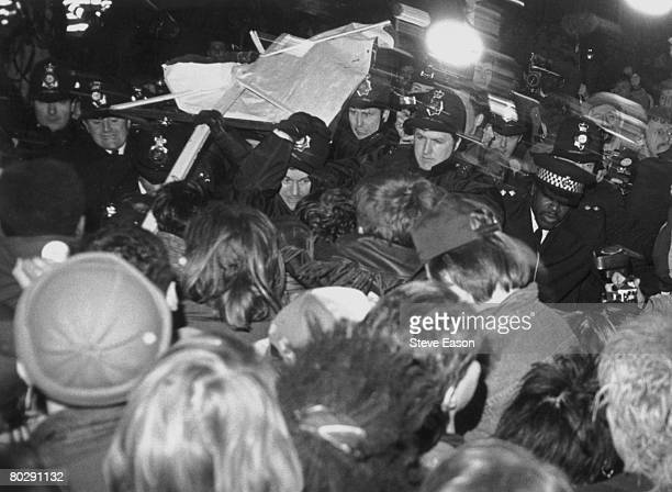 British police officers clashing with rioters during the London Poll Tax Riots 12th March 1990