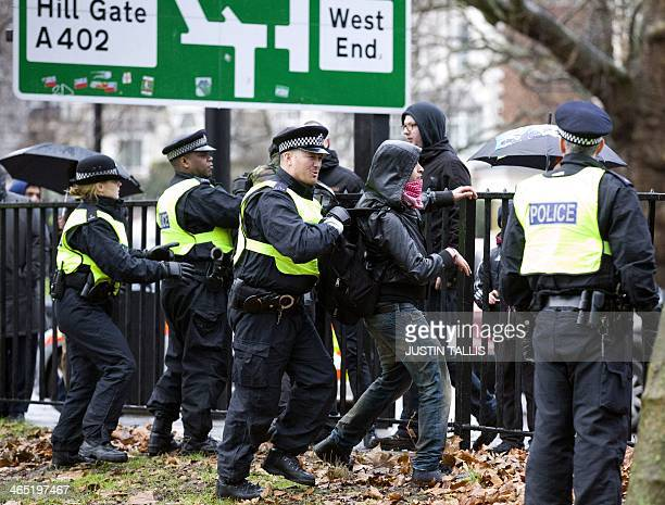 British police officers hold back protesters trying to reach Gabor Vona leader of Hungary's farright Jobbik party as he addresses expatriate...