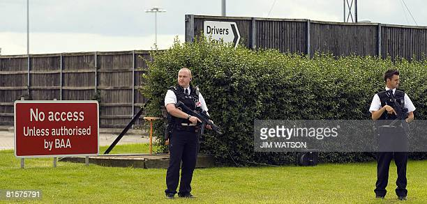 British police officers stand guard as US President George W Bush walks off Air Force One at London Heathrow airport west London on June 15 2008 US...