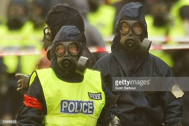 British police officers wear chemical protection suits during an exercise at Bank Underground Station September 7 2003 in London The exercise aimed...