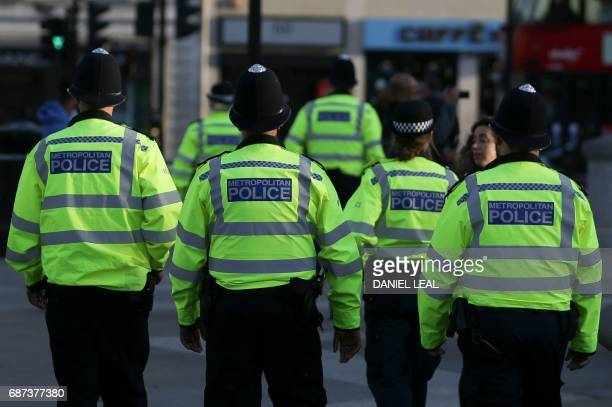 British police patrol through Trafalgar Square in central London on May 23 2017 a day after a deadly terror attack at the Ariana Grande concert at...
