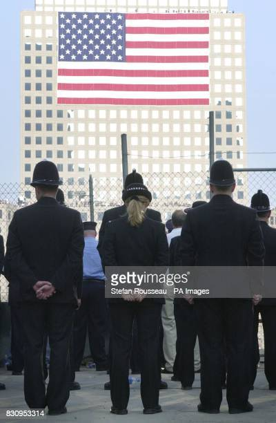 British policemen and women observe a minute's silence at Ground Zero in New York on the first anniversary of the terrorist attacks on the World...