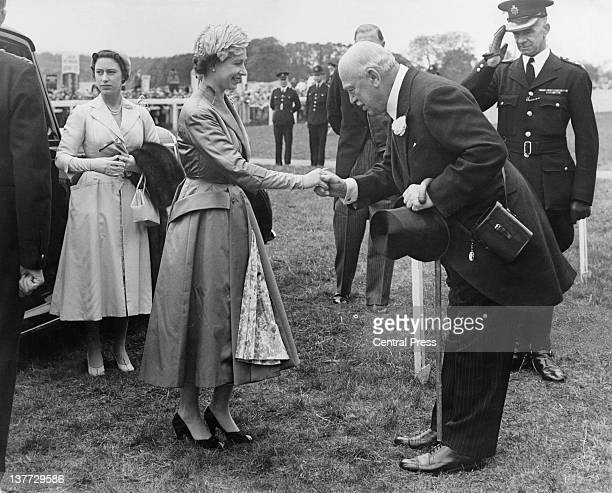 British politician and racehorse owner Harry Primrose 6th Earl of Rosebery greets Queen Elizabeth II on her arrival at the grandstand at the Derby...