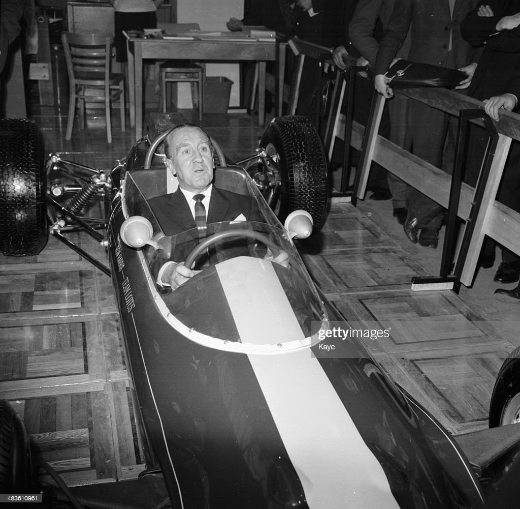 British politician Ernest Marples sitting in a racing car at a car show, England, January 22nd 1964.