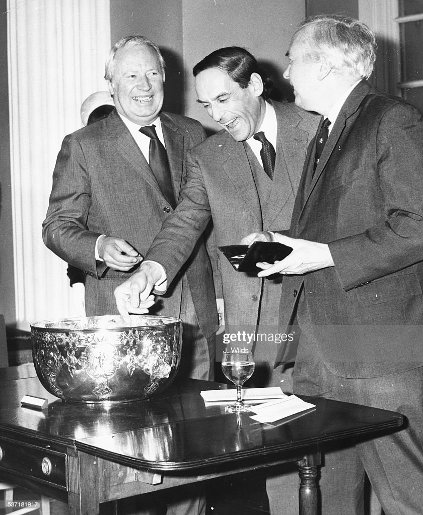 British politicians laughing together at the birthday party of Lady Churchill; Conservative leader Edward Heath, Liberal leader Jeremy Thorpe and Labour leader and Prime Minister Harold Wilson, April 1st 1974.
