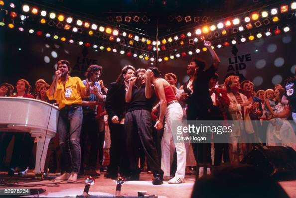 British pop acts gathered on stage for the finale of the Live Aid concert at Wembley Stadium in London 13th July 1985 The group includes George...