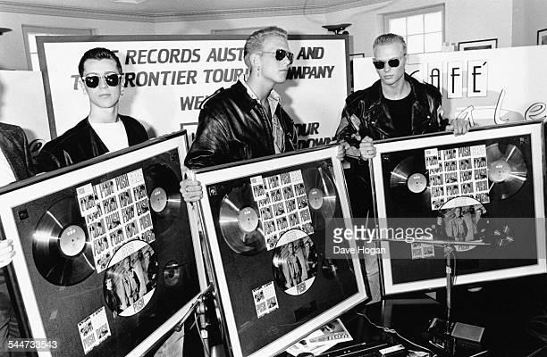 British pop band 'Bros' Craig Logan Matt Goss and Luke Goss holding gold records of their album 'Push' in Australia November 1st 1988