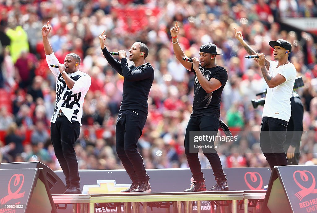 British pop band JLS perform ahead of the match between Manchester United Legends and Real Madrid Legends at Old Trafford on June 2, 2013 in Manchester, England.