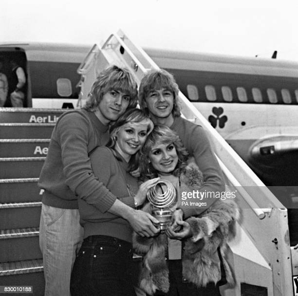 British pop group 'Bucks Fizz' at London's Heathrow Airport arriving back with their trophy after they won the Eurovision Song Contest in Dublin with...