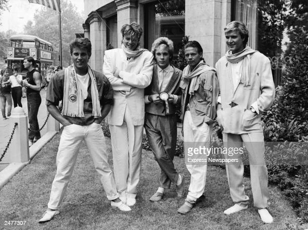 British pop group Duran Duran smile and laugh while posing on a lawn England c 1983 LR Brothers Roger and John Taylor Nick Rhodes Andy Taylor and...
