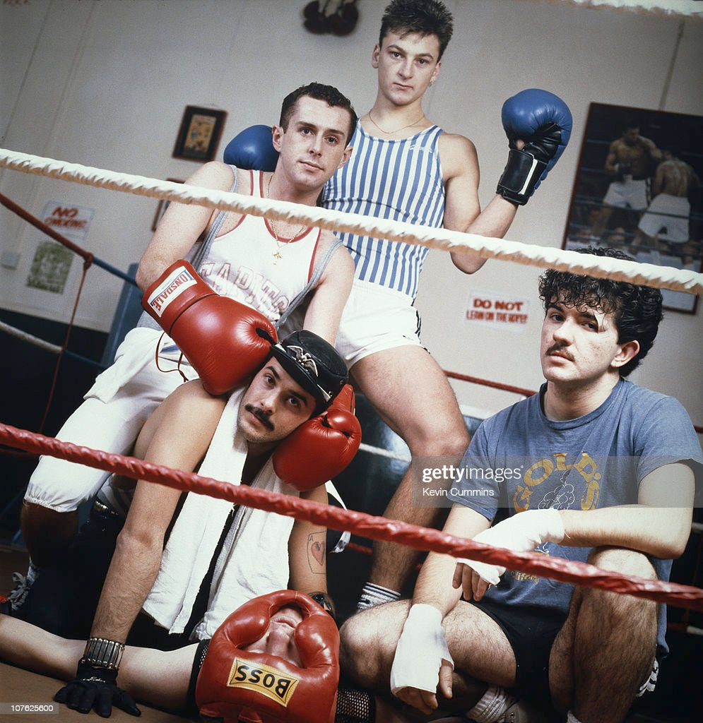 British pop group Frankie Goes To Hollywood pose in a boxing ring, 21st November 1983. Left to right: Holly Johnson, Paul Rutherford (sitting), Brian Nash (on canvas), Mark O'Toole and <a gi-track='captionPersonalityLinkClicked' href=/galleries/search?phrase=Peter+Gill+-+Frankie+Goes+To+Hollywood&family=editorial&specificpeople=15200922 ng-click='$event.stopPropagation()'>Peter Gill</a>.