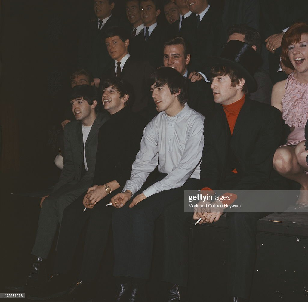 British pop group The Beatles at the Beatles Christmas Show, at the Astoria Cinema, Finsbury Park, London, December 1963. Left to right: Paul McCartney, Ringo Starr, George Harrison (1943 - 2001) and John Lennon (1940 - 1980). With them are English singers Billy J. Kramer (behind Harrison) and Cilla Black (far right).