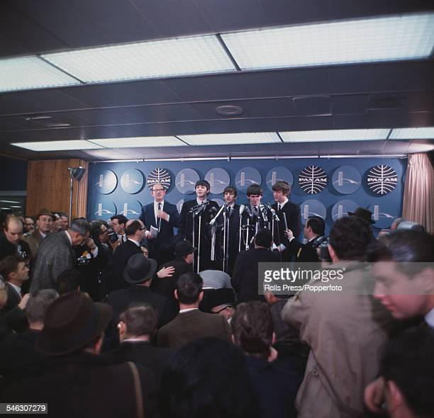 British pop group The Beatles attend a press conference at Kennedy International airport in New York having arrived from London for a 13 day US tour...