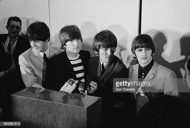 British pop group the Beatles hold a press conference at the airport upon their arrival to begin a US tour Los Angeles California August 1964...
