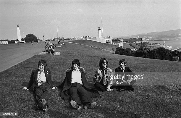 British pop group The Beatles John Lennon Paul McCartney George Harrison and Ringo Starr take a break during the filming of 'The Magical Mystery...