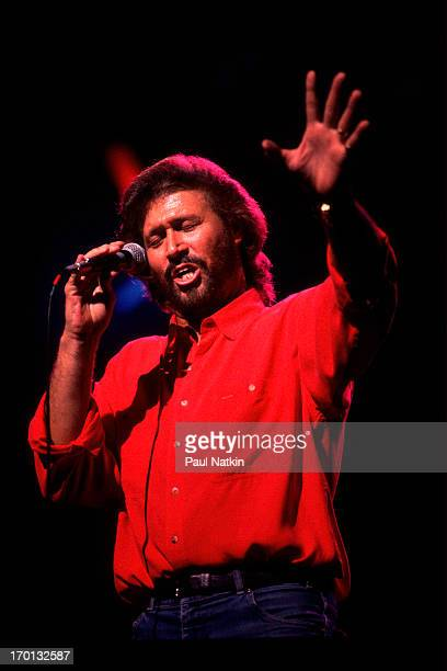 British pop singer Barry Gibb of the group the Bee Gees performs on stage at the Poplar Creek Music Theater Hoffman Estates Illinois July 31 1989