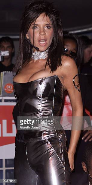 British pop singer Victoria Beckham at the Eden Club in Ibiza on August 12 2000 performing her new single Out of my Mind with Dane Bowers