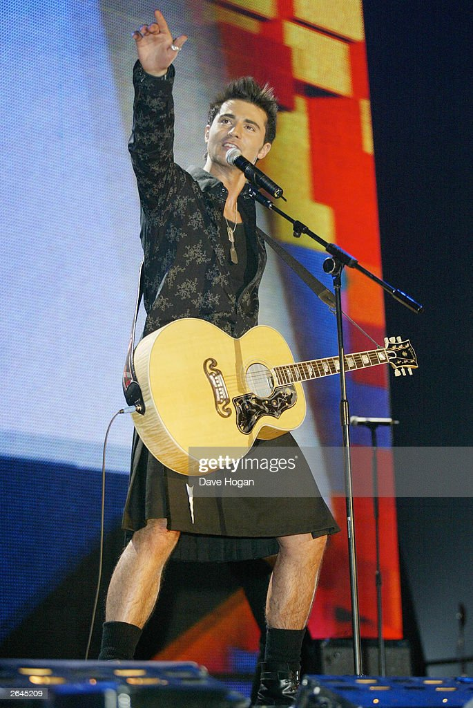 British pop star Darius Danesh performs on stage at the Smash Hits Poll winners party at the London Docklands Arena on November 24, 2002 in London.
