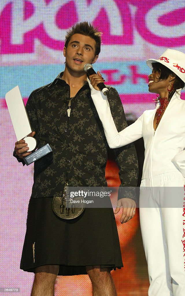 British pop star Darius Danesh receives an award at the Smash Hits Poll Winners Party 2002 at the London Docklands Arena on November 24, 2002 in London.