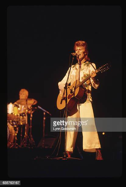 British pop star David Bowie in the beginning of his glamrock period He released 'The Man Who Sold the World' in 1970 He stands onstage playing...