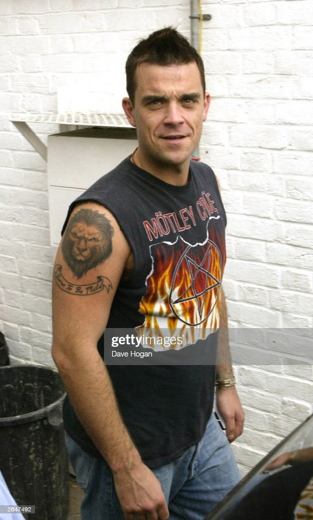 British pop star Robbie Williams signs his 80 million pound record contract with EMI Records at EMI Headquarters on October 2, 2002 in London.
