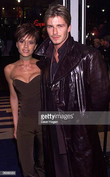 British pop star Victoria Beckham and British footballer David Beckham arrive at the charity premiere of the film 'Withnail and I' at the Odeon West...