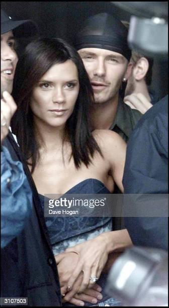 British pop star Victoria Beckham and her boyfriend British footballer David Beckham attend 'Party In The Park' held at Hyde Park on July 9 2000 in...