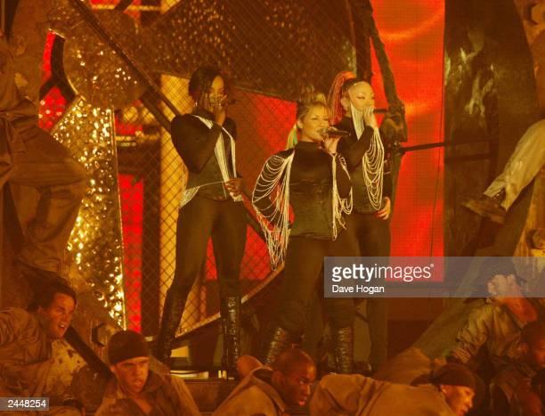 British pop stars Heidi Range Keisha Buchanan and Mutya Buena of girl band Sugababes perform on stage at the Brit Awards 2003 Show at Earls Court on...