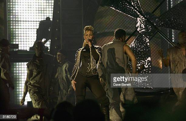 British pop stars Heidi Range Mutya Buena and Keisha Buchanan perform on stage at The Brit Awards 2003 held at Earl's Court Exhibition Centre on...