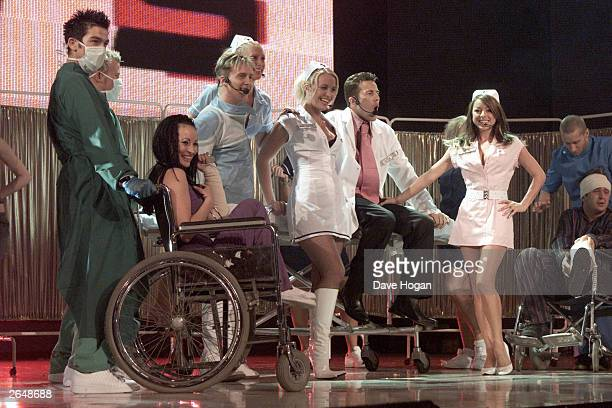 British pop stars Ian 'H' Watkins Faye Tozer Clare Richards Lee LatchfordEvans and Lisa Scott Lee of the pop group 'Steps' perform on stage at the...