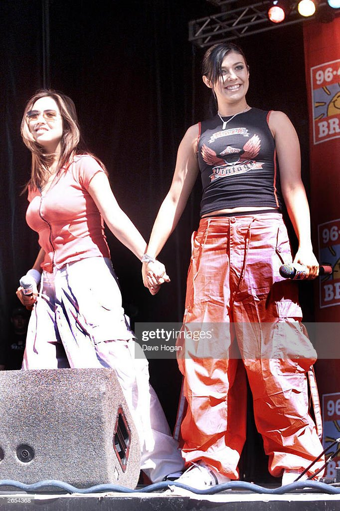 British pop stars Kym Marsh and Myleene Klass of the pop group 'Hear'Say' perform on stage at the annual 'Party in the Park' on August 27, 2001 in Birmingham, Great Britain.