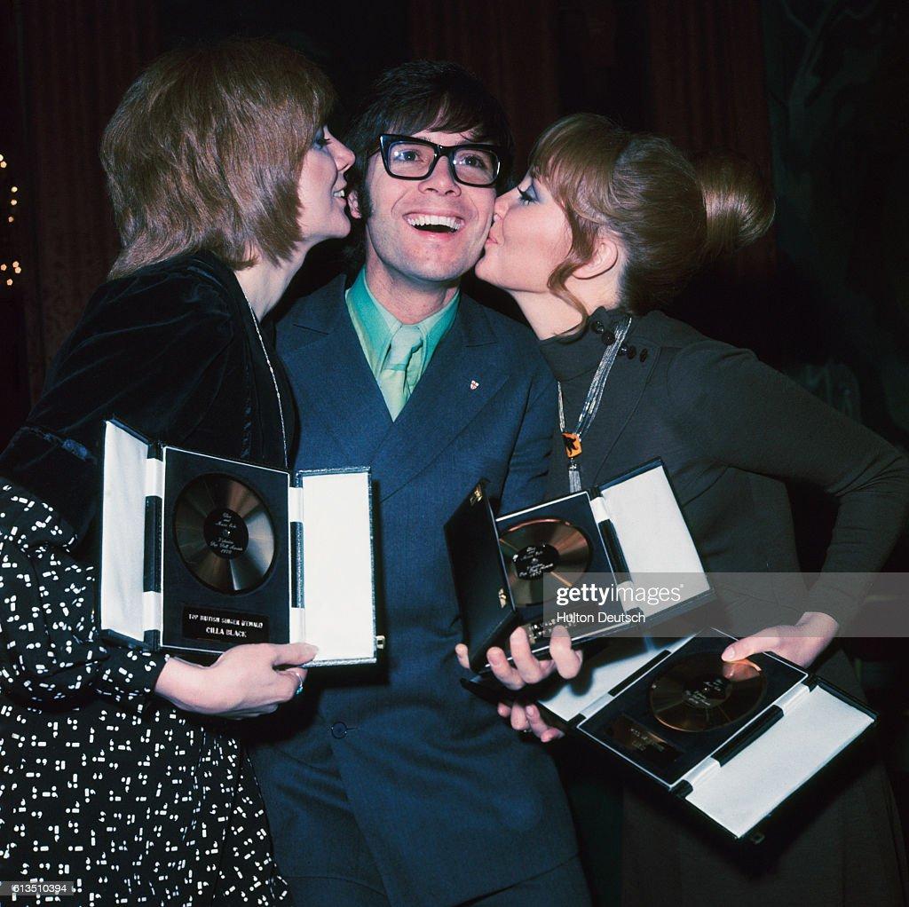 British Pop Stars Lulu (l), Cilla Black (r), and Cliff Richard (c) celebrate.
