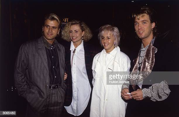 British pop stars Steve Norman and Martin Kemp of Spandau Ballet with their girlfriends including Shirley of Wham on the right