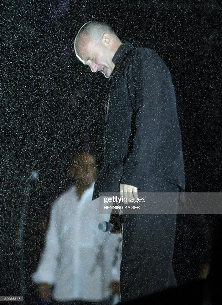 British popstar Phil Collins performs 12 June 2004 at Cologne's Rhein Energie Stadion in the pouring rain, on a concert of his 'First Final Farewell Tour'.