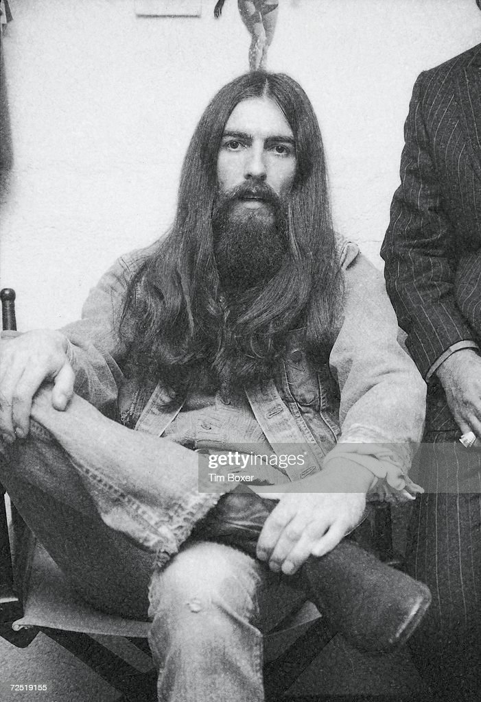 British popular rock and roll guitarist and singer <a gi-track='captionPersonalityLinkClicked' href=/galleries/search?phrase=George+Harrison&family=editorial&specificpeople=90945 ng-click='$event.stopPropagation()'>George Harrison</a> (1943 - 2001), formerly of the Beatles, sits for a photo during a party, 1971.