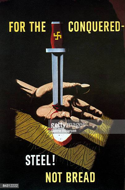 A British poster from World War II depicts a hand pinned to a table by a German dagger with the words 'For the conquered steel not bread' circa 1942...