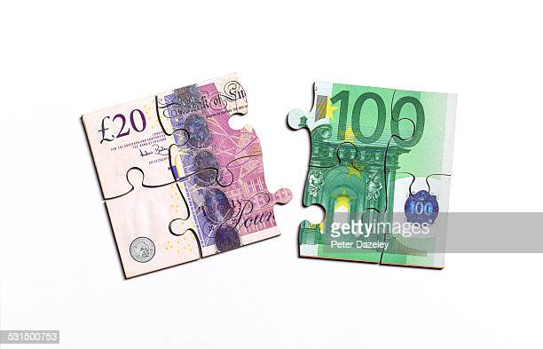 British pound note and euro note jigsaw