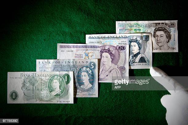 British Pound Sterling banknotes featuring Britain's Queen Elizabeth II are displayed during a photo call for an exhibition celebrating the 50th...