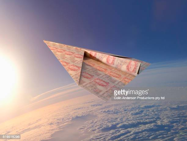 British pounds folded into paper airplane in atmosphere
