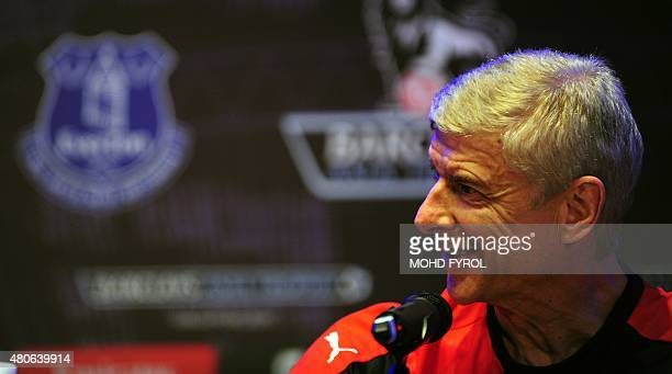 British Premier League football club Arsenal manager Arsene Wenger speaks during a press conference for the Barclays Asia Trophy 2015 in Singapore on...