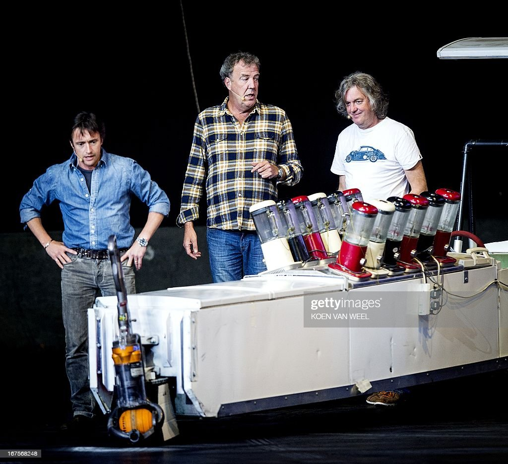 British presenters Richard Hammond, Jeremy Clarkson and James May are pictured during the rehearsal of Top Gear Live at the Ziggo Dome in Amsterdam on April 26, 2013. The presenters of the BBC television program are back with their show in Amsterdam after three years. AFP PHOTO / ANP - KOEN VAN WEEL = netherlands out