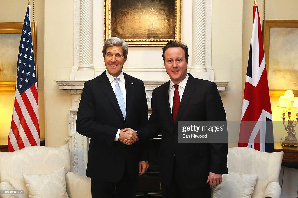 British Prime David Cameron (R) welcomes US Secretary of State John Kerry to 10 Downing Street on February 25, 2013 in London, England. Mr Kerry is on an 11-day tour where he is due to visit Berlin, Paris, Rome, Ankara, Cairo, Riyadh, Abu Dhabi and Doha.The US Secretary of State is to hold a press conference with Foreign Secretary William Hague in London later today.