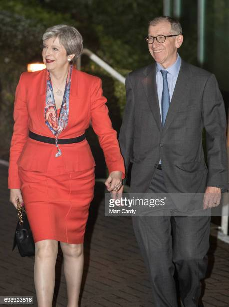 British Prime Minister and Conservative Party leader Theresa May and husband Philip May arrive for the election count at the Magnet Leisure Centre on...