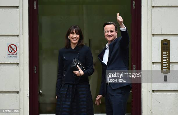 British Prime Minister and Leader of the Conservative Party David Cameron and his wife Samantha arrive at Conservative Party headquarters in London...