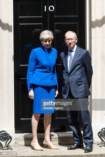 British Prime Minister and leader of the Conservative Party Theresa May and her husband Phillip May pose for a photo as they stand on the steps of...