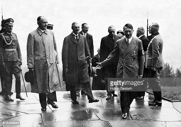 British Prime Minister Arthur Neville Chamberlain Adolf Hilter and his interpreter Dr Paul Schmidt meet in Berchtesgaden Germany