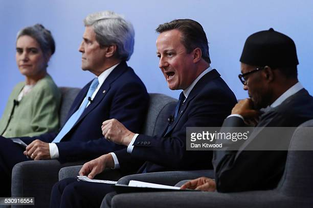 British Prime Minister Cameron is joined by Sarah Chayes a senior associate in the Democracy and Rule of Law Program US Secretary of State John Kerry...
