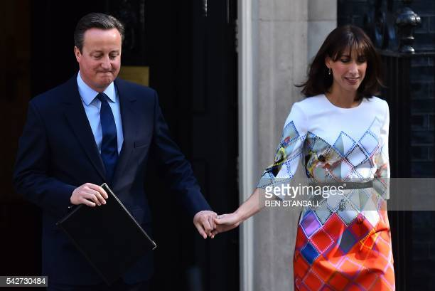 TOPSHOT British Prime Minister David Cameron accompanied by his wife Samantha arrives to speak to the press in front of 10 Downing street in central...