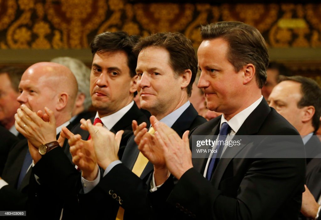 British Prime Minister David Cameron (R) accompanied by Labour party leader <a gi-track='captionPersonalityLinkClicked' href=/galleries/search?phrase=Ed+Miliband&family=editorial&specificpeople=4376337 ng-click='$event.stopPropagation()'>Ed Miliband</a> (L) and Deputy Prime Minister <a gi-track='captionPersonalityLinkClicked' href=/galleries/search?phrase=Nick+Clegg&family=editorial&specificpeople=579276 ng-click='$event.stopPropagation()'>Nick Clegg</a> (C) applaud after Irish President Michael D. Higgins delivered a speech at the Houses of Parliamenton April 08, 2014 in London, United Kingdom. Ireland's President Michael D. Higgins is making the first state visit by a president of the republic since it gained independence from neighbouring Britain. The visit comes three years after Queen Elizabeth II made a groundbreaking trip to the republic, which helped to heal deep-rooted unease and put British-Irish relations on a new footing. Higgins' return visit will be seen as an official sign of further progress following the hard-won peace in Northern Ireland, which remains part of the United Kingdom.