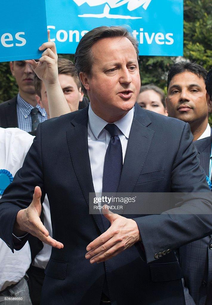 British Prime Minister David Cameron addresses councillors and supporters following the local elections, outside Peterborough Conservative Club in Peterborough, central England, on May 6, 2016. Early results Friday from British local and regional elections seen as a key test for opposition Labour leader Jeremy Corbyn showed strong gains for Scottish nationalists, as London looked set to elect its first Muslim mayor. London was on track to become the first EU capital with a Muslim mayor as voters went to the polls Thursday after a bitter campaign between Prime Minister David Cameron's Conservatives and the opposition Labour party. / AFP / POOL / Rick Findler